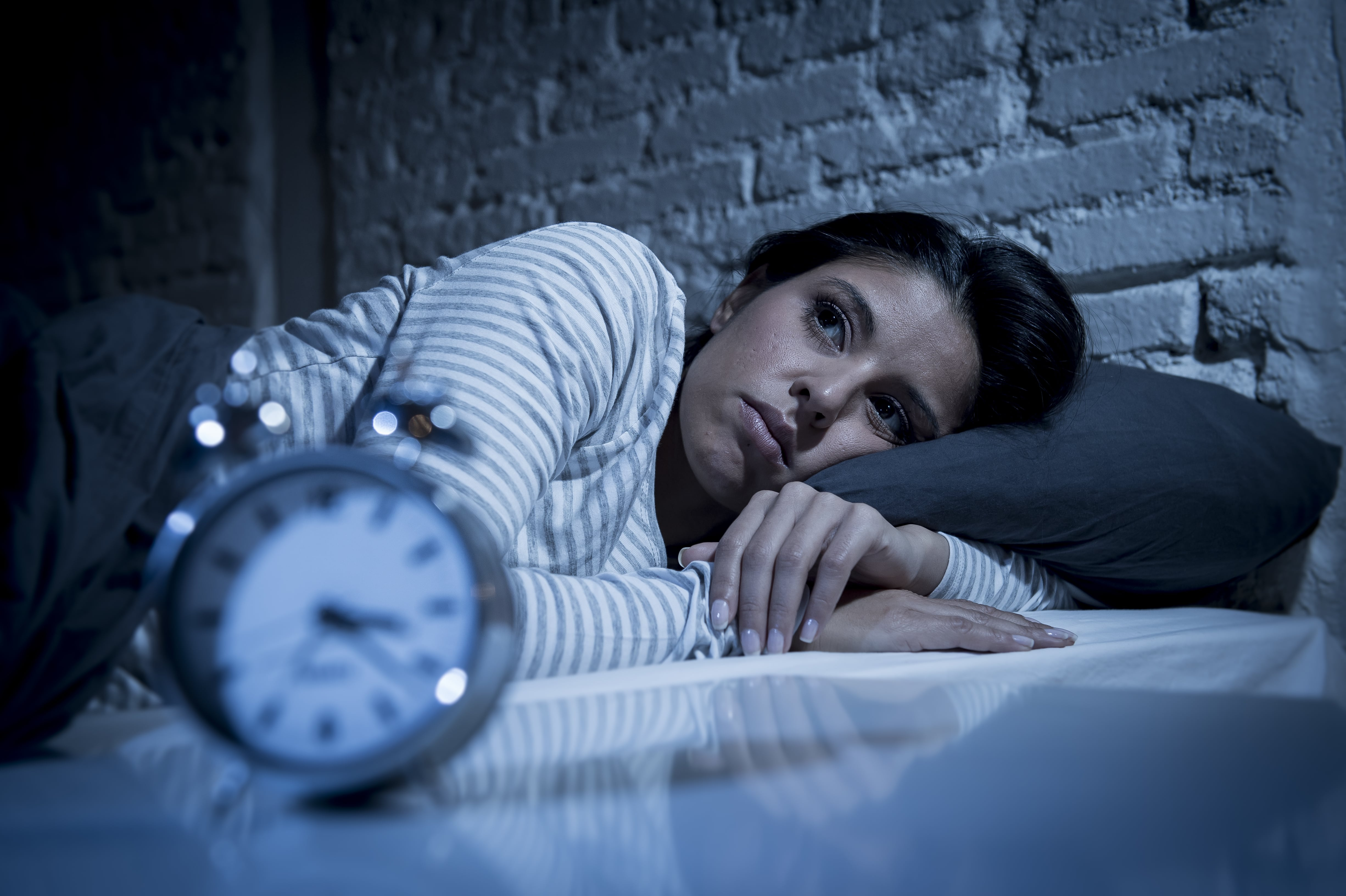 Woman with insomnia lying awake in bed